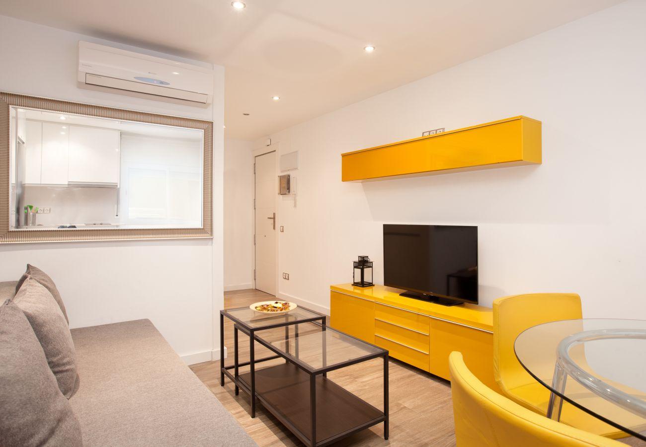séjour avec TV dans appartement Apartment INDUSTRIA très proche de l'hôpital Sant Pau