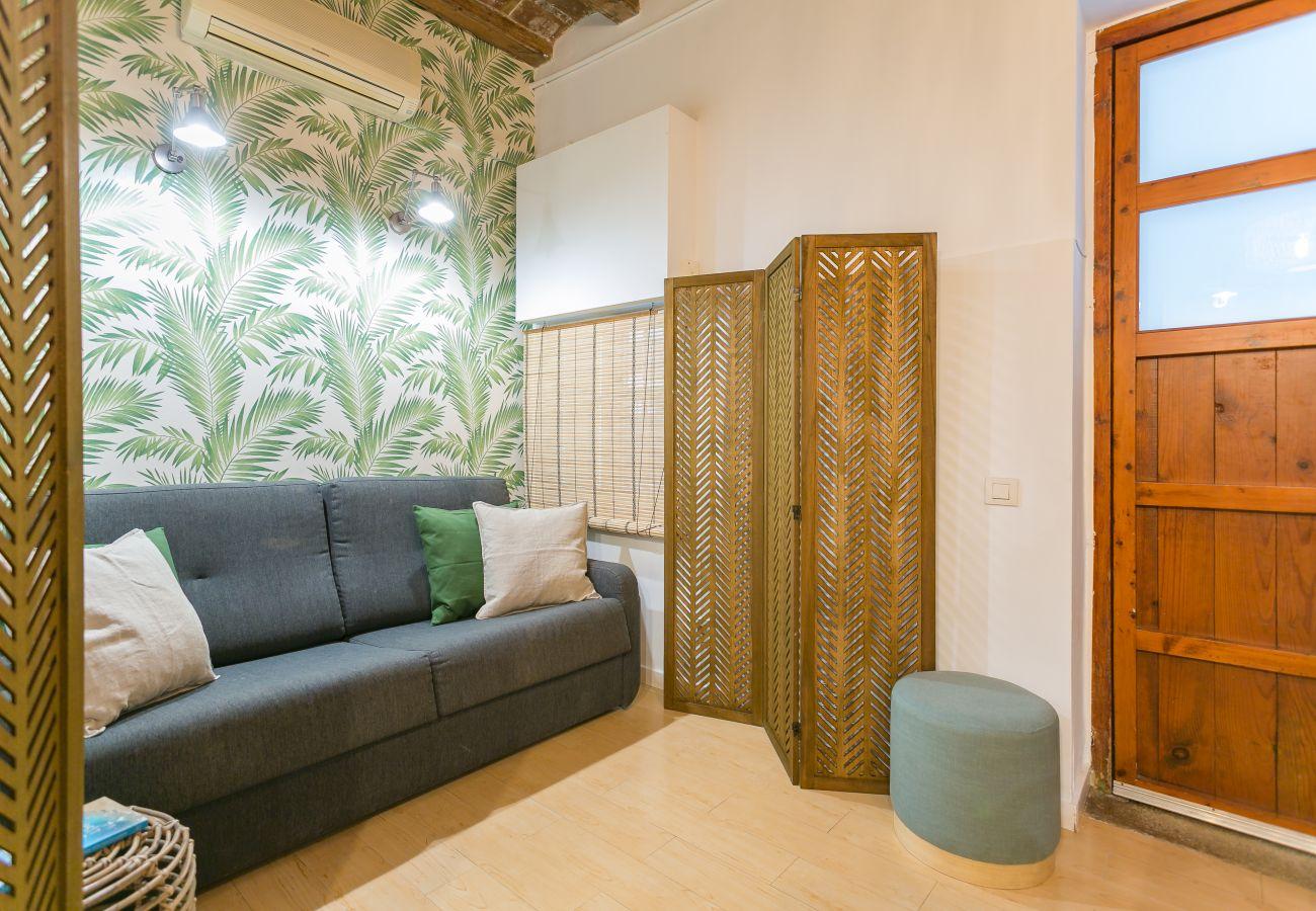 salle de repos coin détente dans un appartement 1 chambre à la Barceloneta